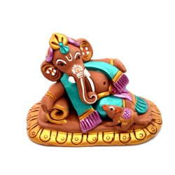 Terracotta handpainted Ganesha resting on sofa