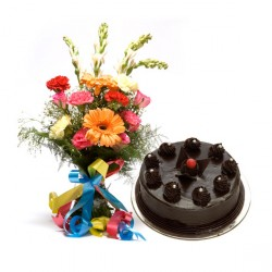 Fresh flower bouquet with chocolate cake